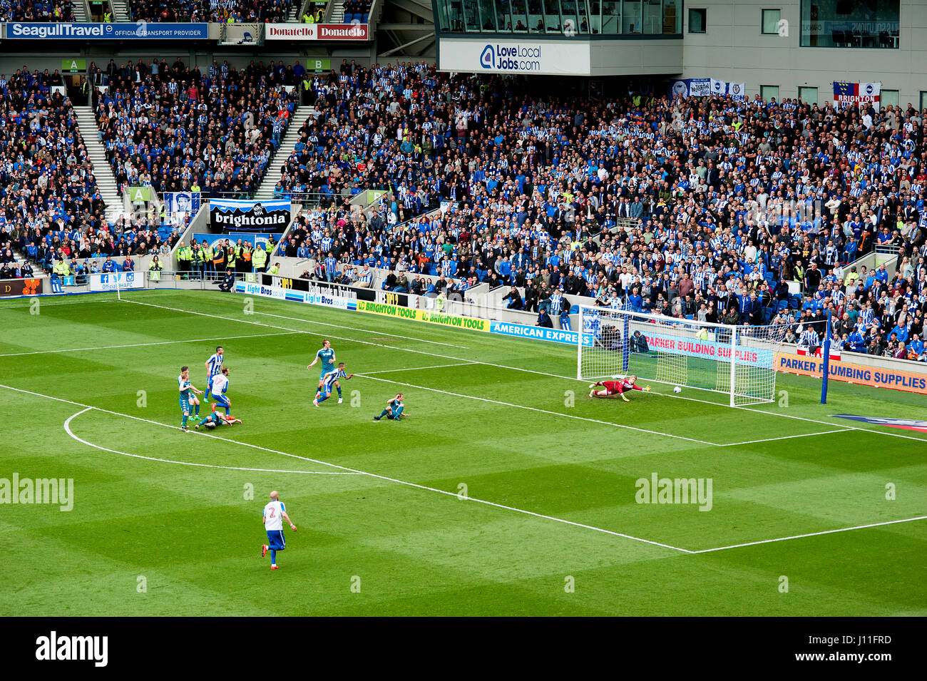 Glenn Murray scores a goal for Brighton and Hove Albion versus Wigan to help his side up to the English Premiership - Stock Image