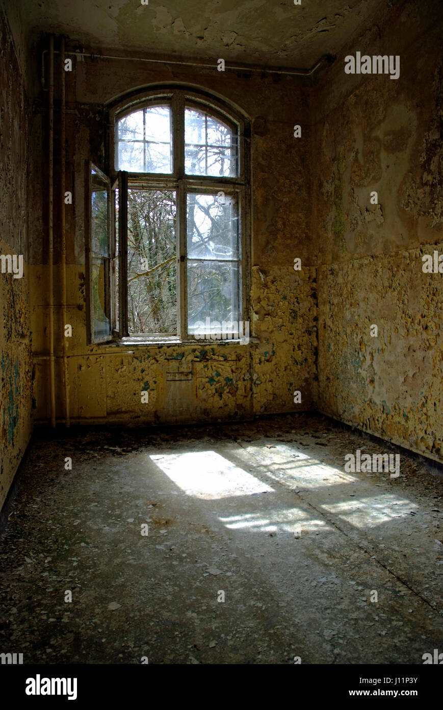 Open window in an abandoned house - Stock Image