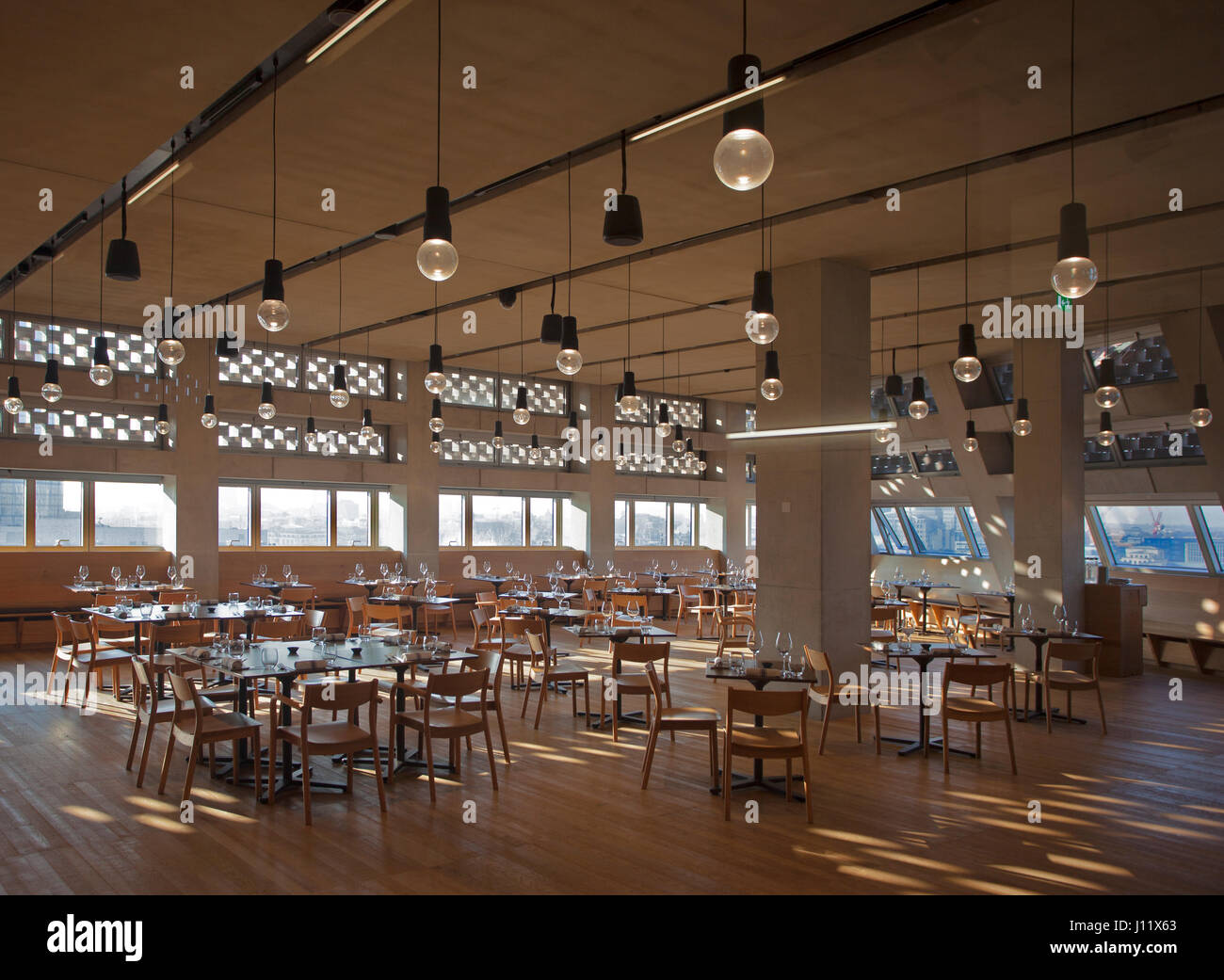 Tate Modern Switch House Restaurant taken in daylight with no customers present, United Kingdom, London - Stock Image