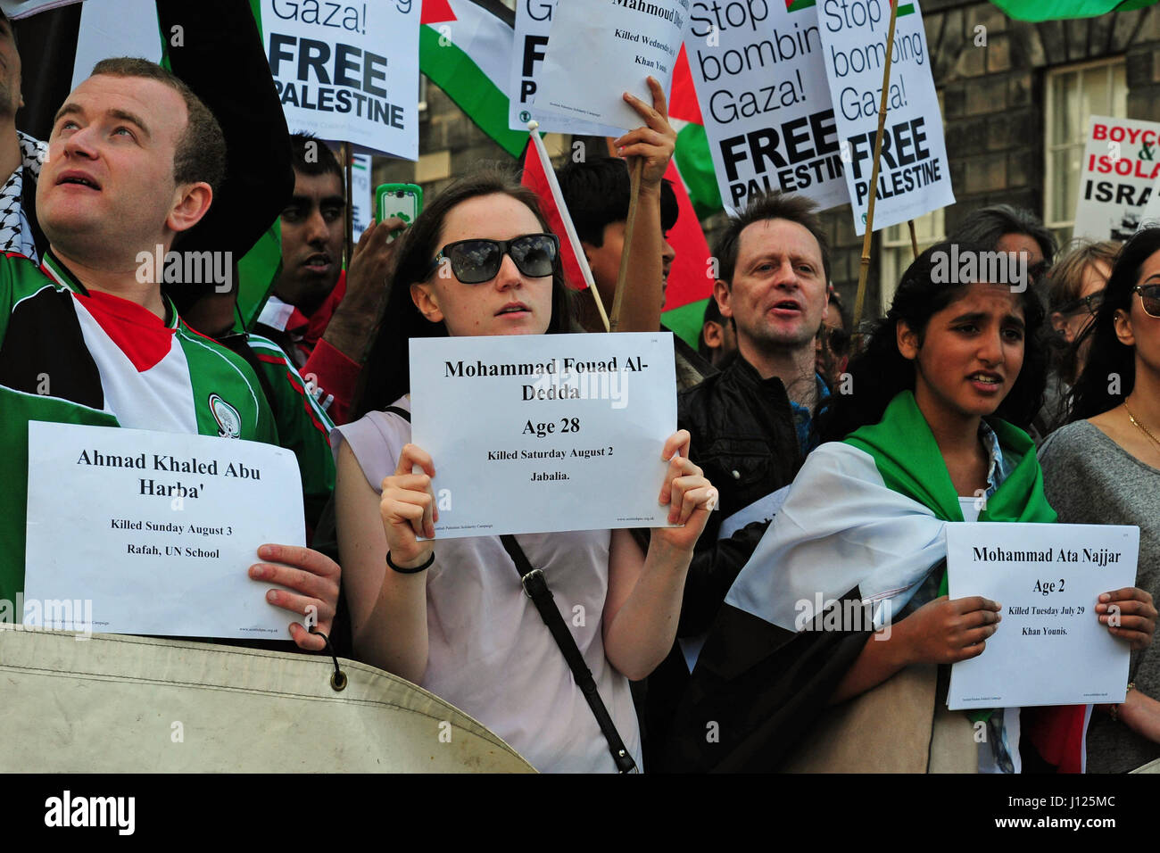 Protesters holde ujp placards with the names of some of those killed in Gaza as several hundred Palestinians  and - Stock Image