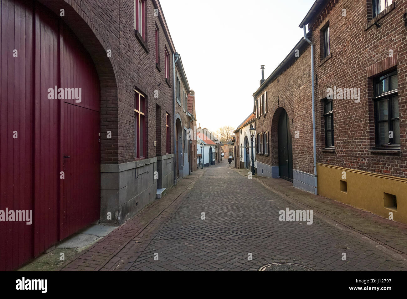 Street view of historic Broekstraat with old farmhouses, Sittard province of Limburg, Netherlands, Holland. - Stock Image