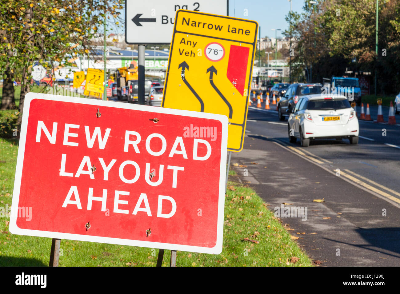 New road layout ahead sign and other road works signs in Nottingham, England, UK - Stock Image