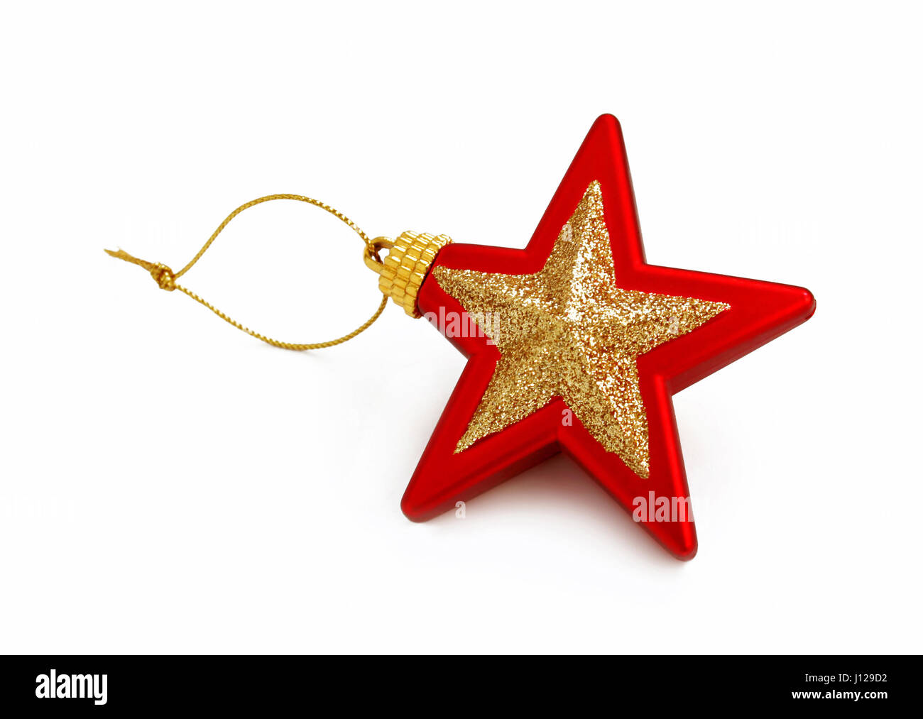 Red and golden christmas star isolated on white - Stock Image