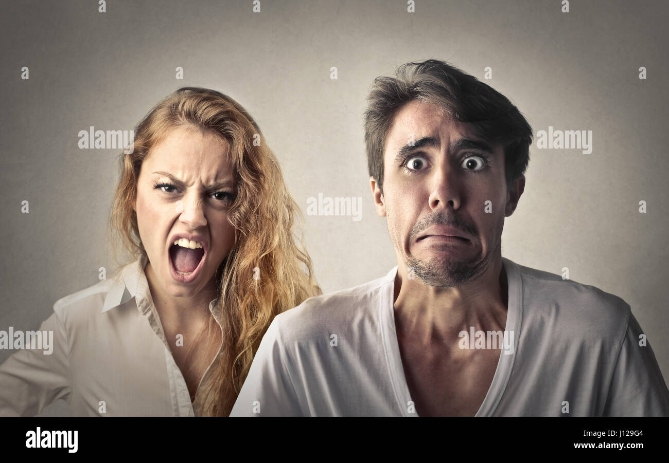 Woman being mad and man being scared - Stock Image