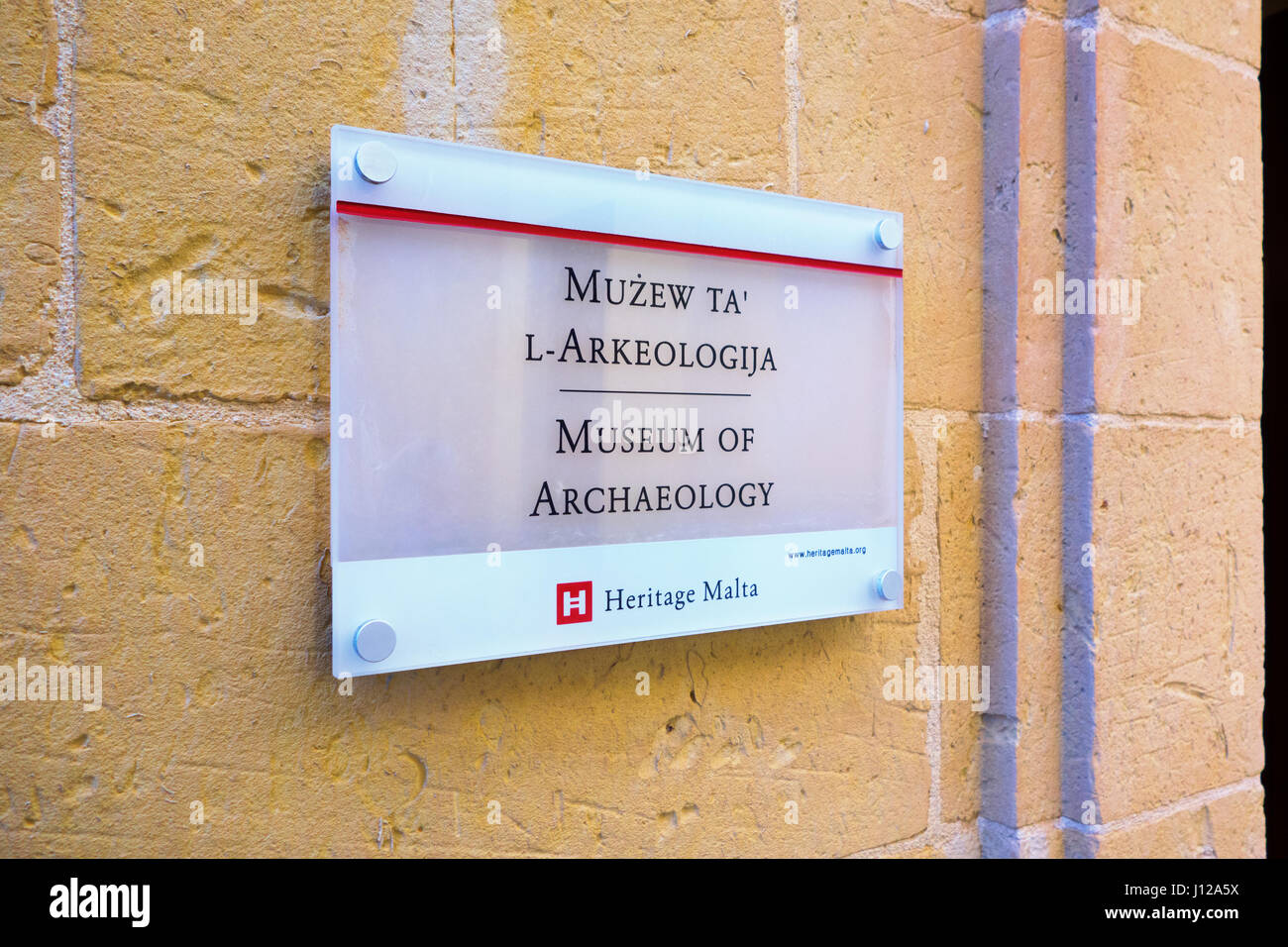 The National Museum of Archaeology sign, Auberge de Provence, in Republic Street, Valletta, Malta, Europe - Stock Image