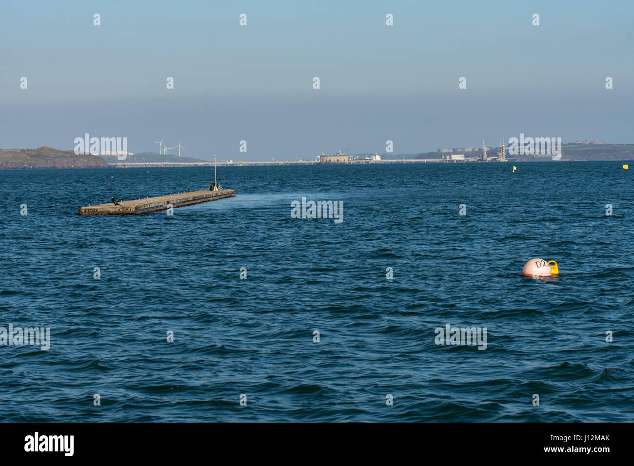 Wind shadow creating calm water in lee of outer pontoon - Stock Image