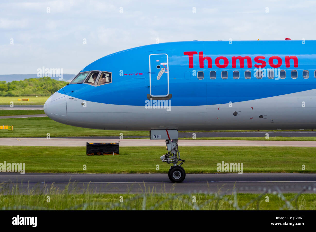 Thomson Airways plane taxiing after landing at Manchester Aiport - Stock Image