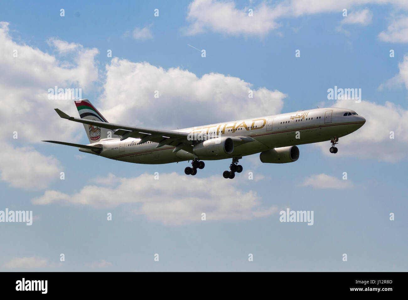 Etihad Airways A330 coming in to land at Manchester Aiport - Stock Image