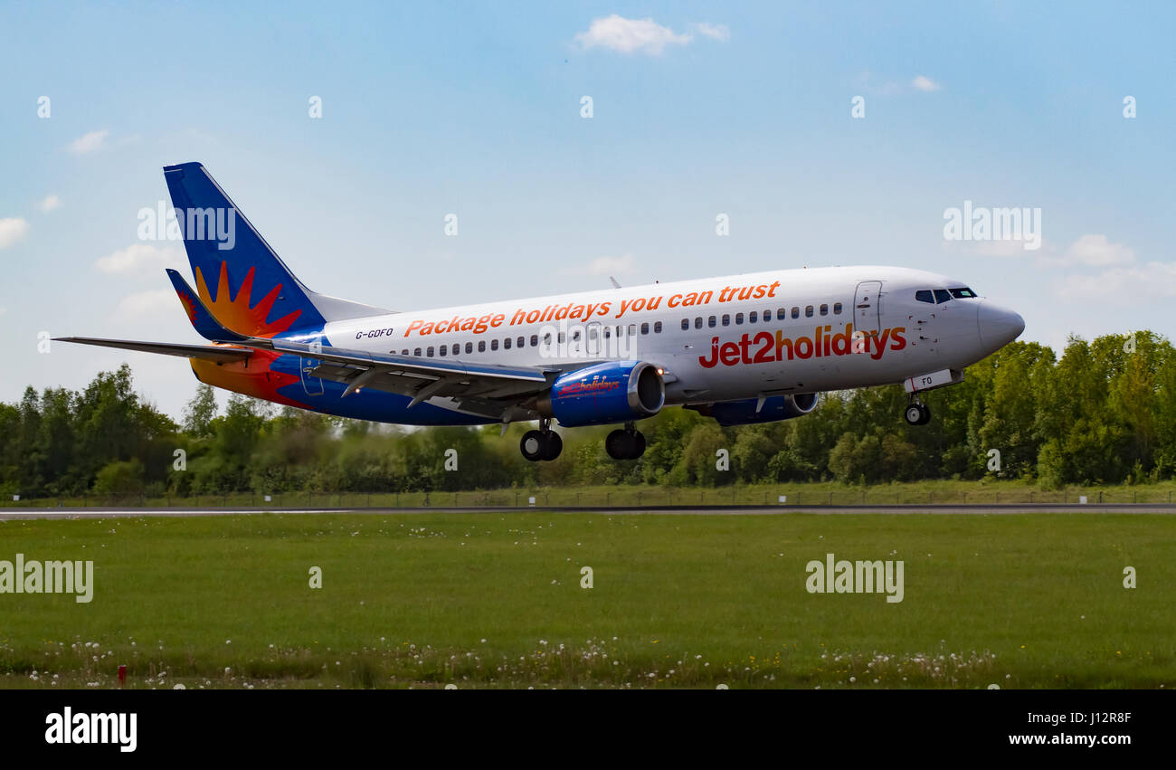 Jet2Holidays Boeing 737 G-GDFO landing at Manchester Airport - Stock Image