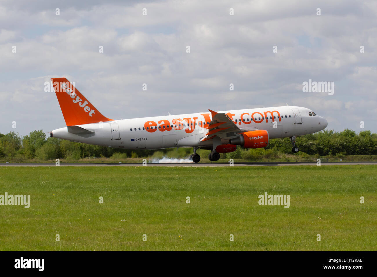 Easyjet Plane G- EZTV Airbus A320-214 landing at Manchester Airport - Stock Image