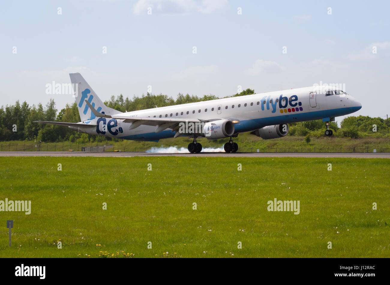 Airplane Flybe G-FBEF Embraer ERJ-195LR Landing at Manchester Airport - Stock Image