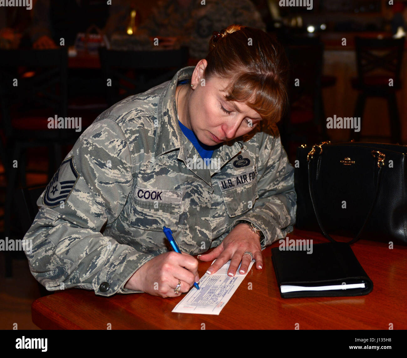 Master Sgt. Jennifer Cook, manpower office superintendent assigned to the 28th Force Support Squadron, donates to - Stock Image