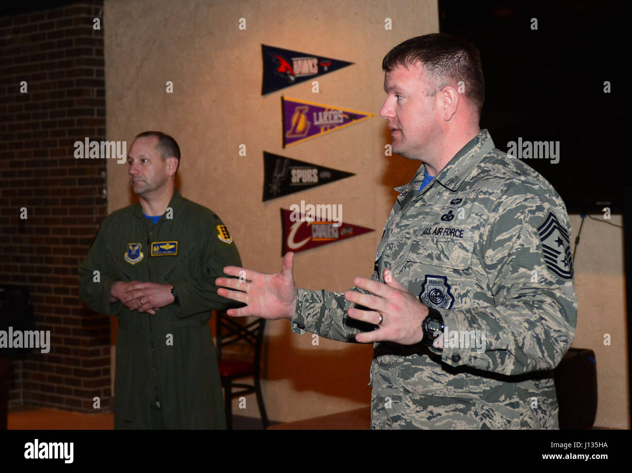 Col. Gentry Boswell, 28th Bomb Wing commander, and Chief Master Sgt. Adam Vizi, 28th Bomb Wing command chief, speak - Stock Image