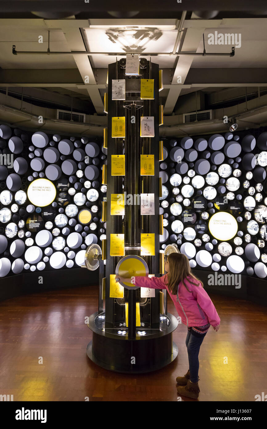 Seattle, Washington: Museum of History & Industry. A young visitor at the Bezos Center for Innovation plays - Stock Image