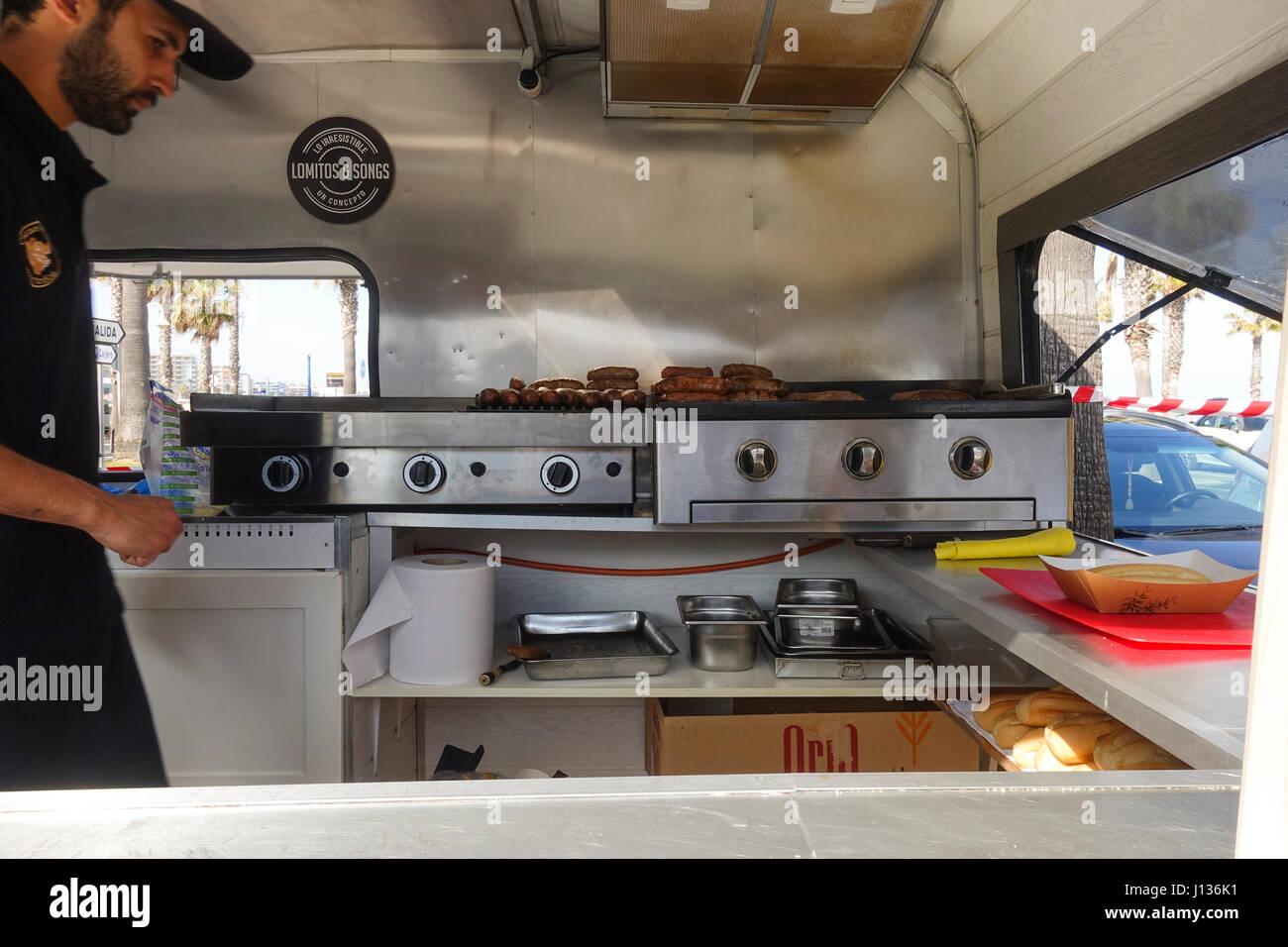 Man Preparing Sausages, View Inside Food Truck, Interior. Spain.