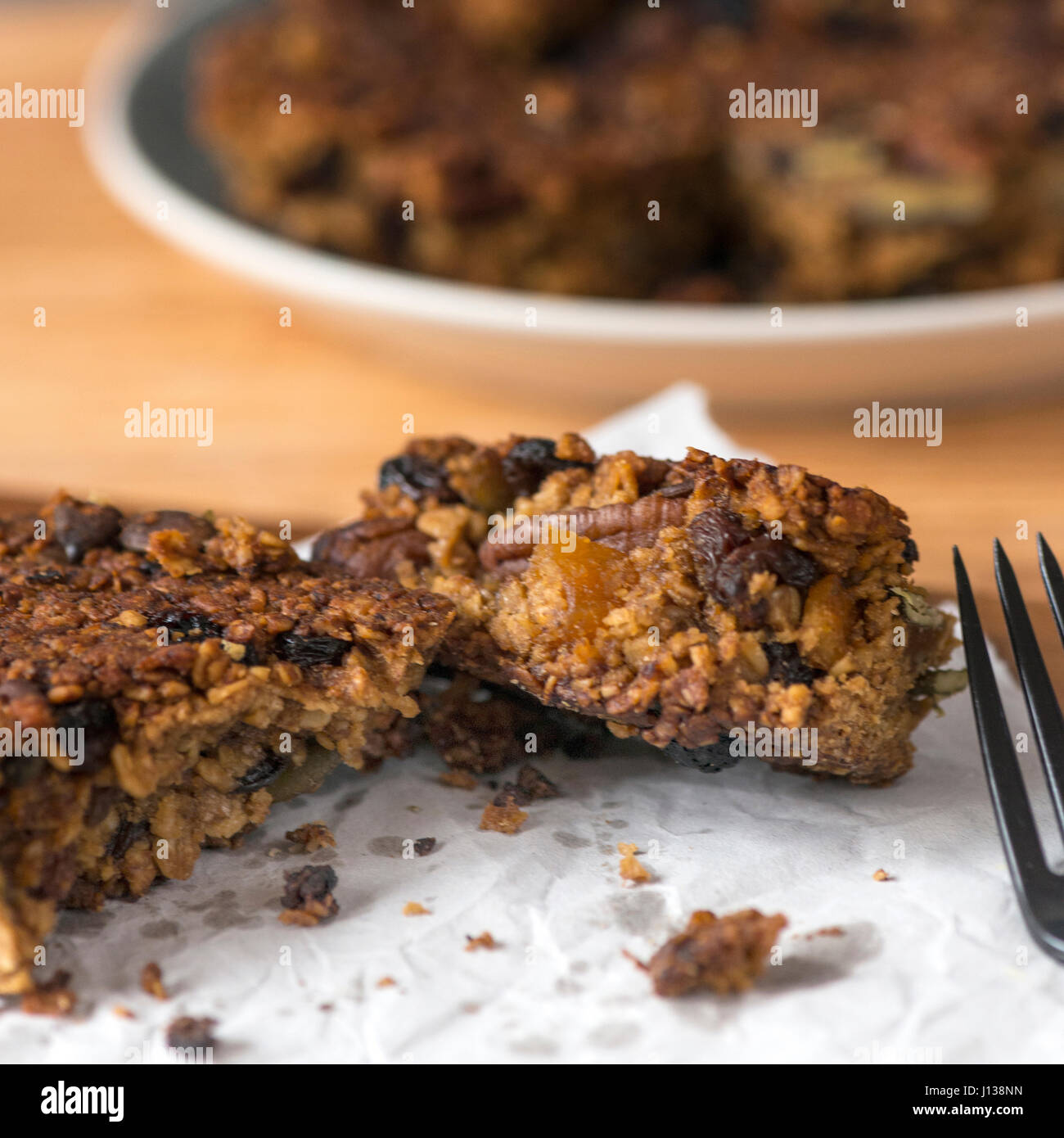 square image of fruit flap jacks made from quinoa plant based snack, - Stock Image
