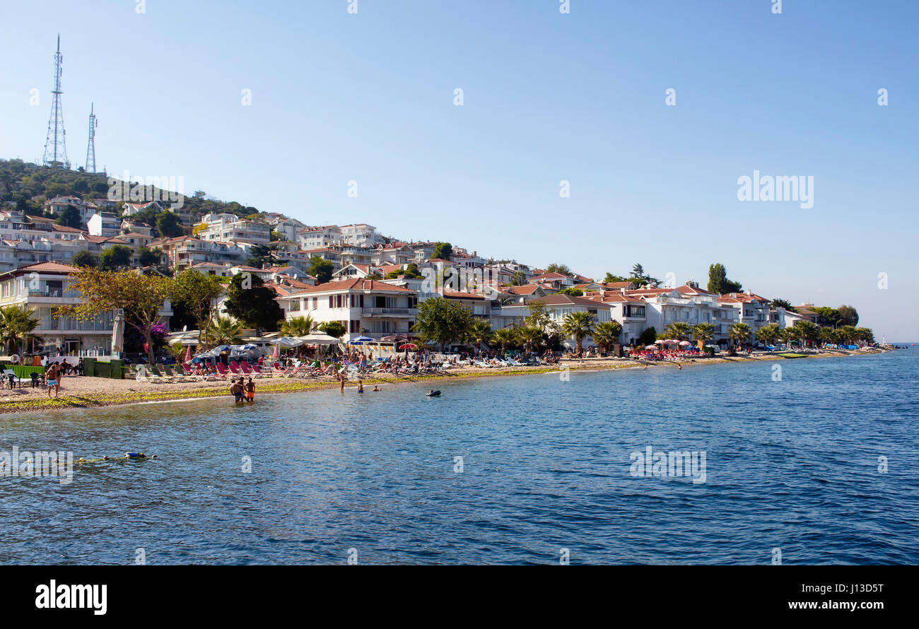 View of beach in Kinaliada which is one of Prince Islands also known as Adalar in Istanbul. Summer houses and people Stock Photo