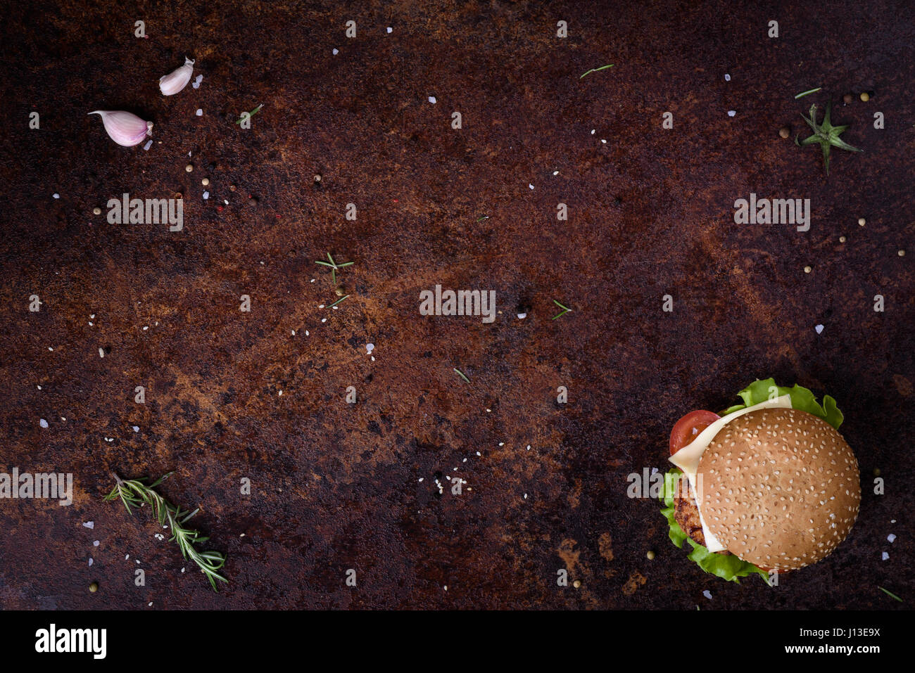 Delicious fresh homemade burger on a rustic table. Menu frame. View from above, space for text. - Stock Image