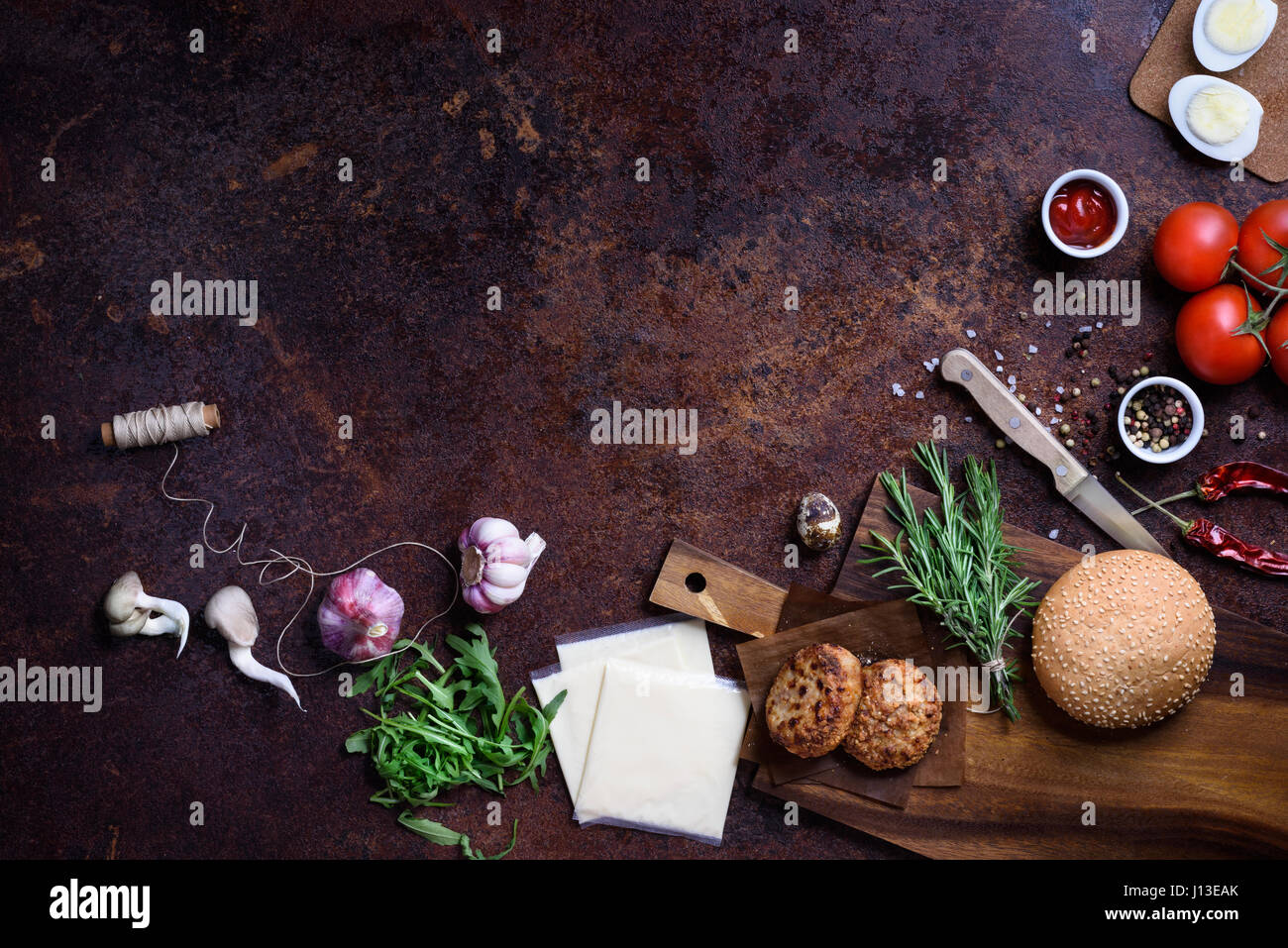 Burger with ingredients, restaurant menu background. Copy space, top view. Beef. Stock Photo