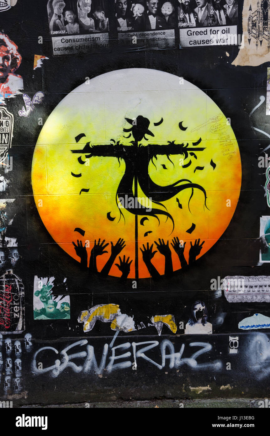 Street art on a wall in East London depicting a scarecrow in Stock ...
