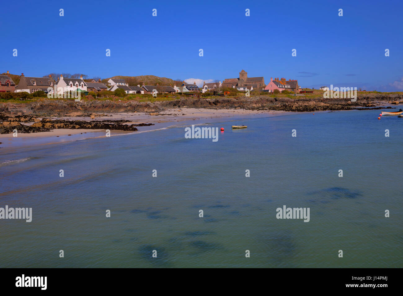 Clear blue sea Isle of Iona Scotland uk beautiful Scottish island - Stock Image