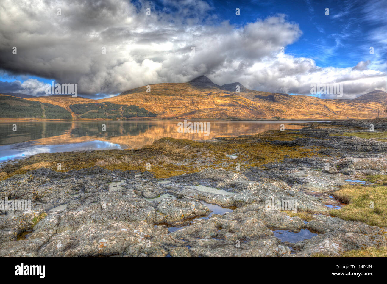 Isle of Mull Scotland UK beautiful Loch Scridain with view to Ben More and Glen More mountains on calm spring day - Stock Image
