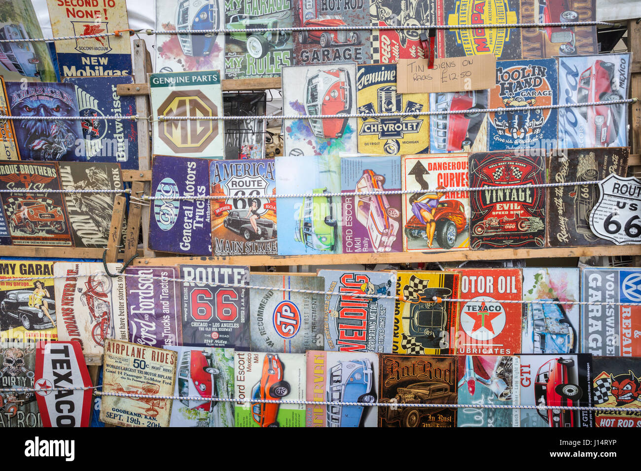 Stall selling old vintage car memorabilia enamel plates Stock Photo ...