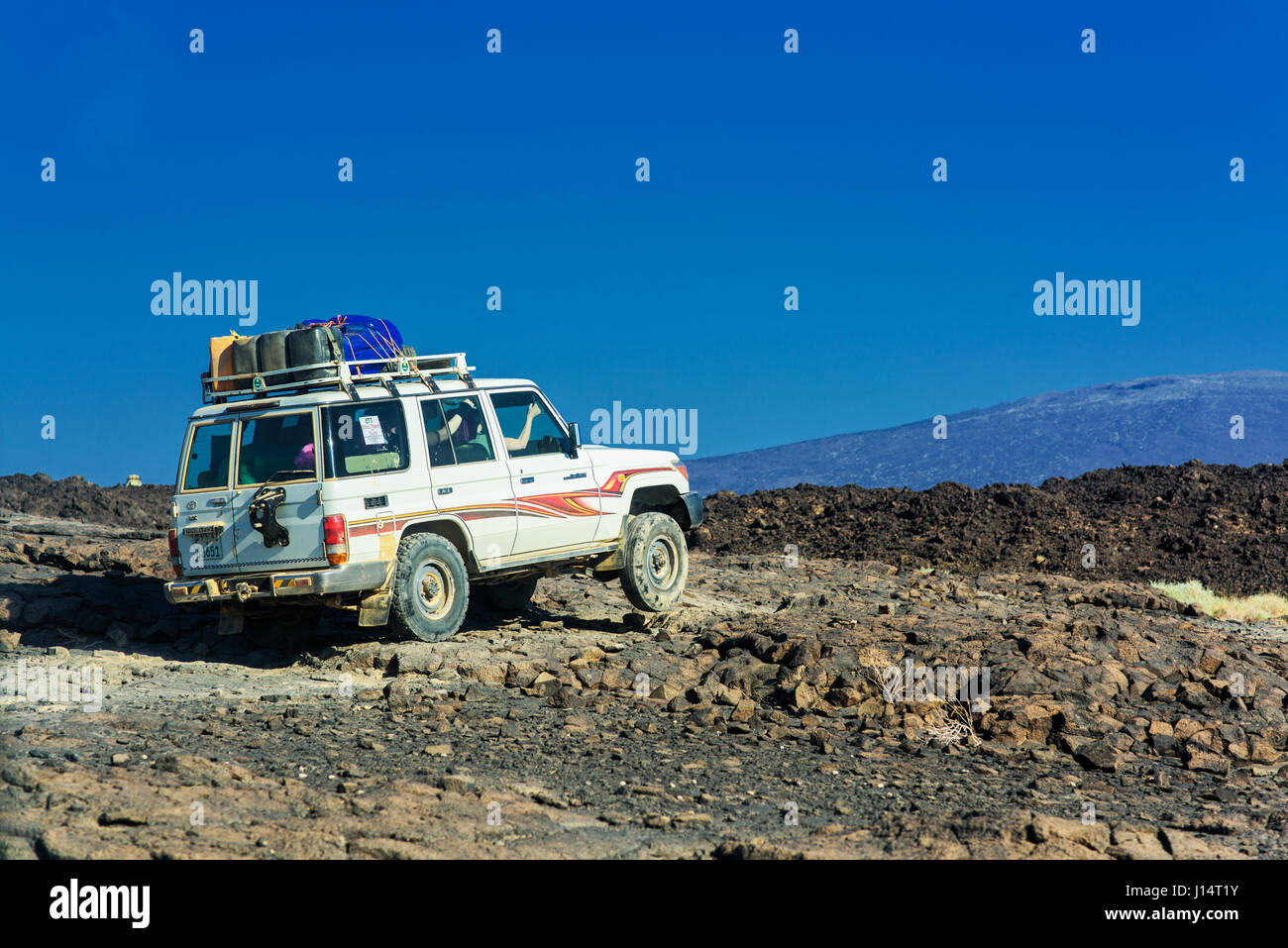AFAR REGION, ETHIOPIA: Journey to the crater by jeep. HAVE YOU ever wondered what it must look like to stare into - Stock Image