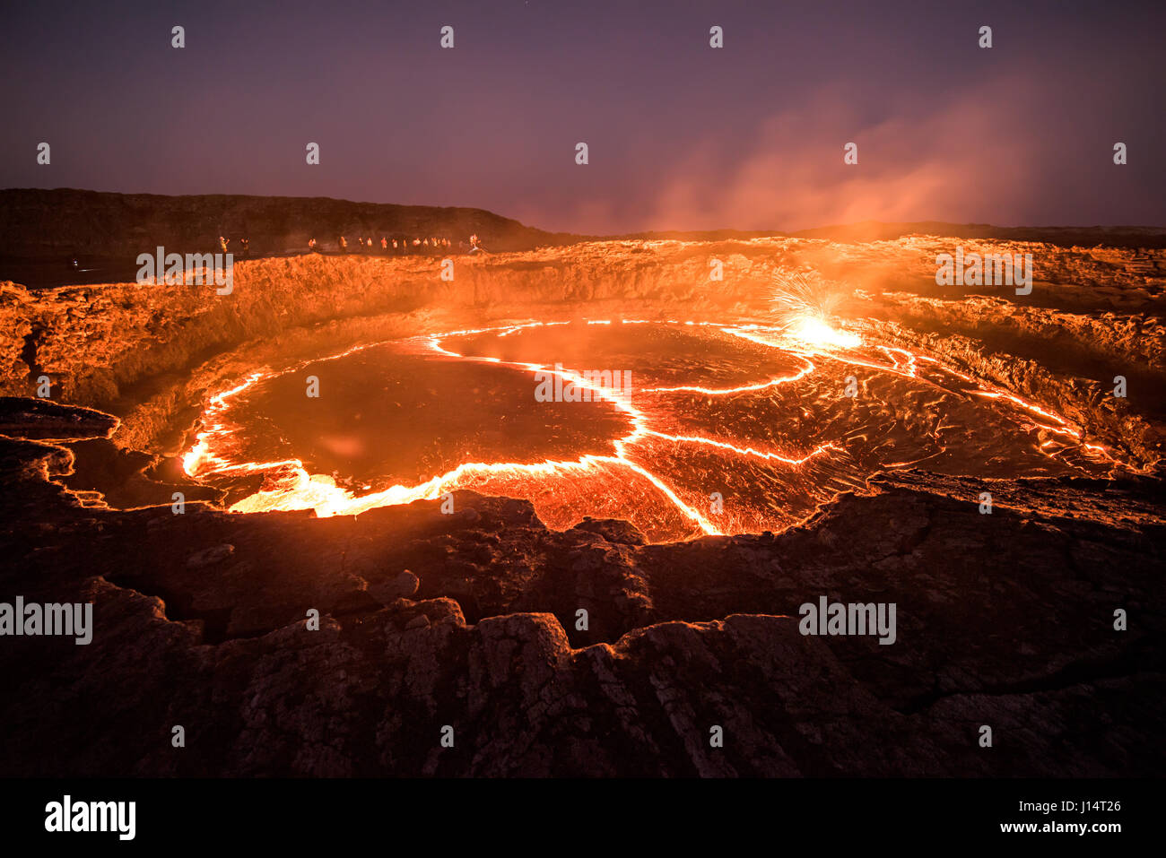 AFAR REGION, ETHIOPIA: Visitors stand around the rim of the lava lake. HAVE YOU ever wondered what it must look - Stock Image