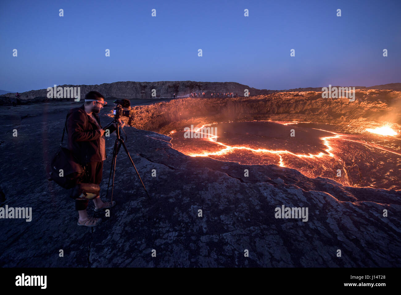 AFAR REGION, ETHIOPIA: A visitor captures the lava lake. HAVE YOU ever wondered what it must look like to stare - Stock Image