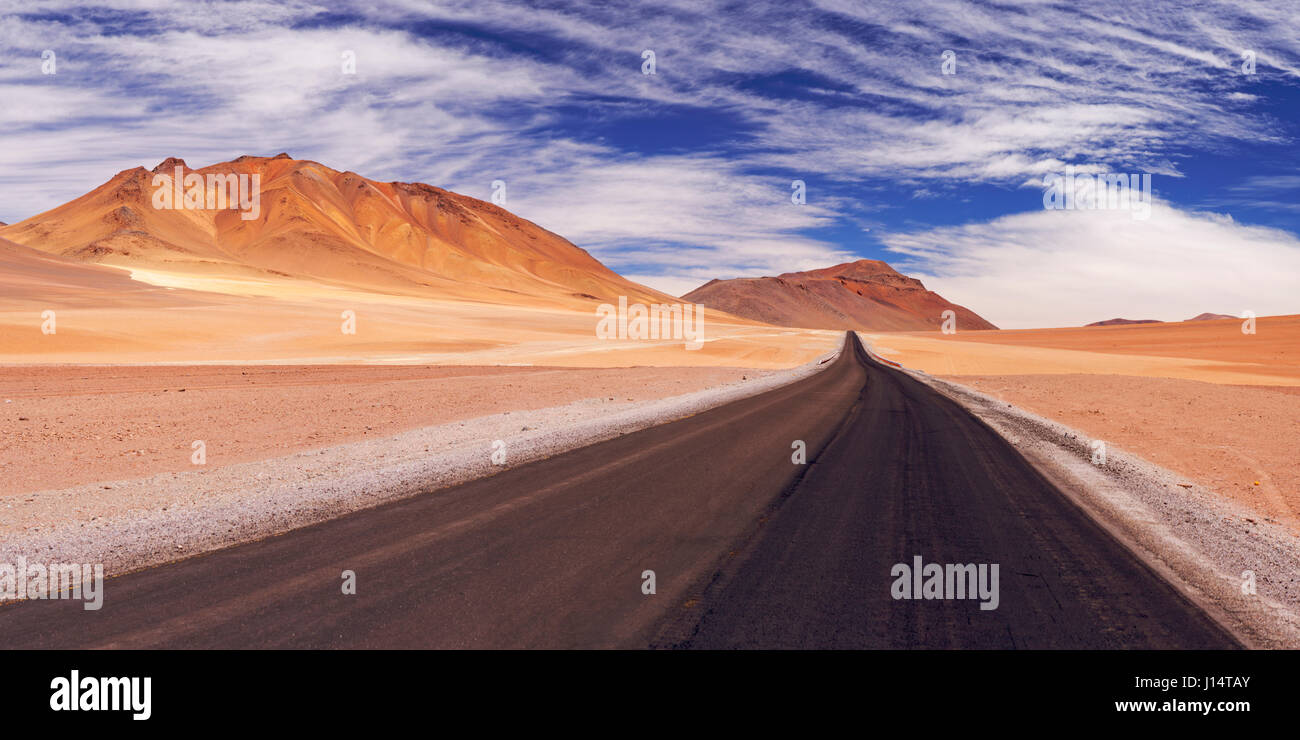 A high desert road through the Chilean Altiplano at an altitude of 4700m. - Stock Image