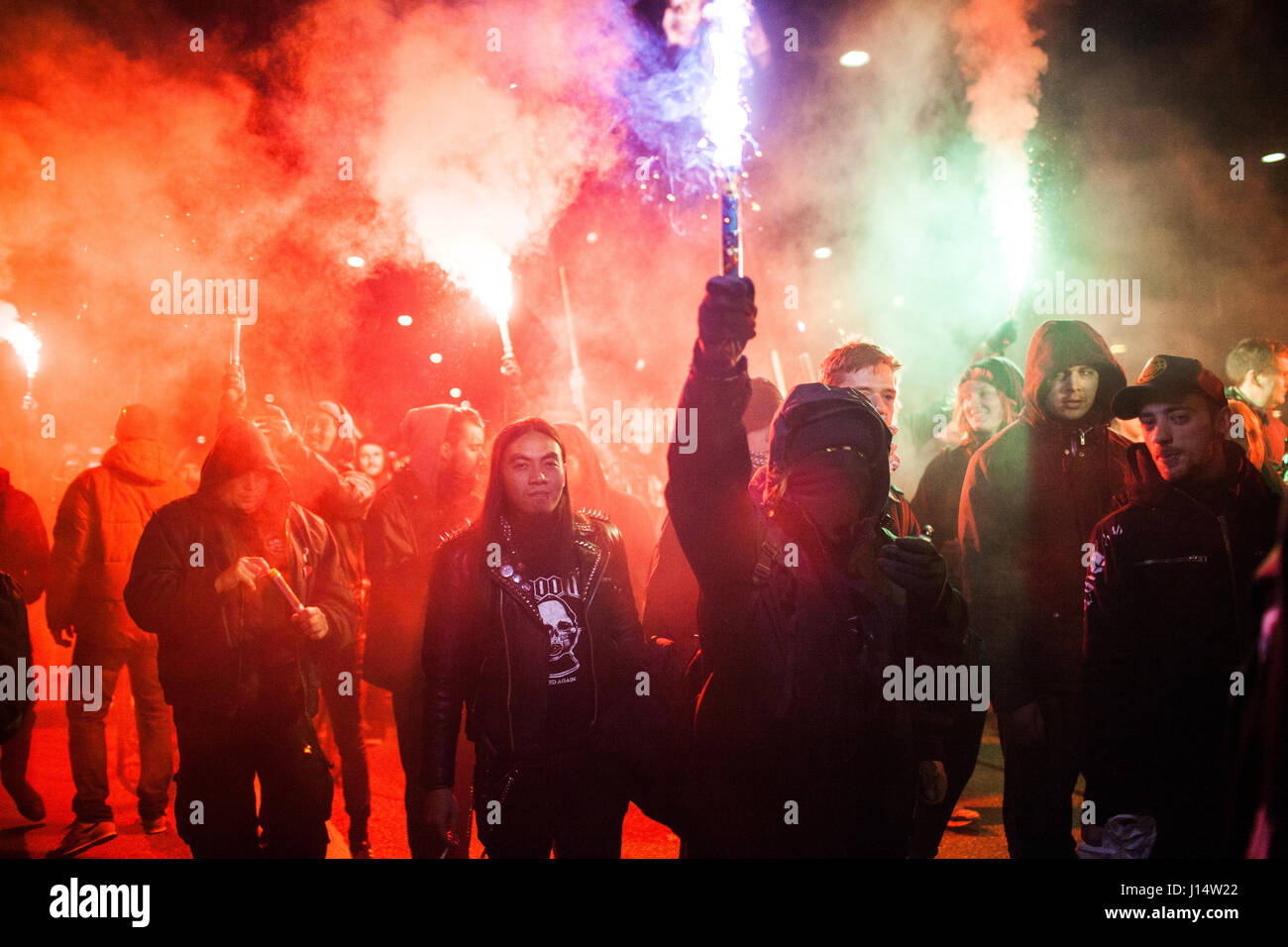 Left wing protesters light up flares during the anti-capitalistic march in the Nørrebro neighborhood in Copenhagen. - Stock Image