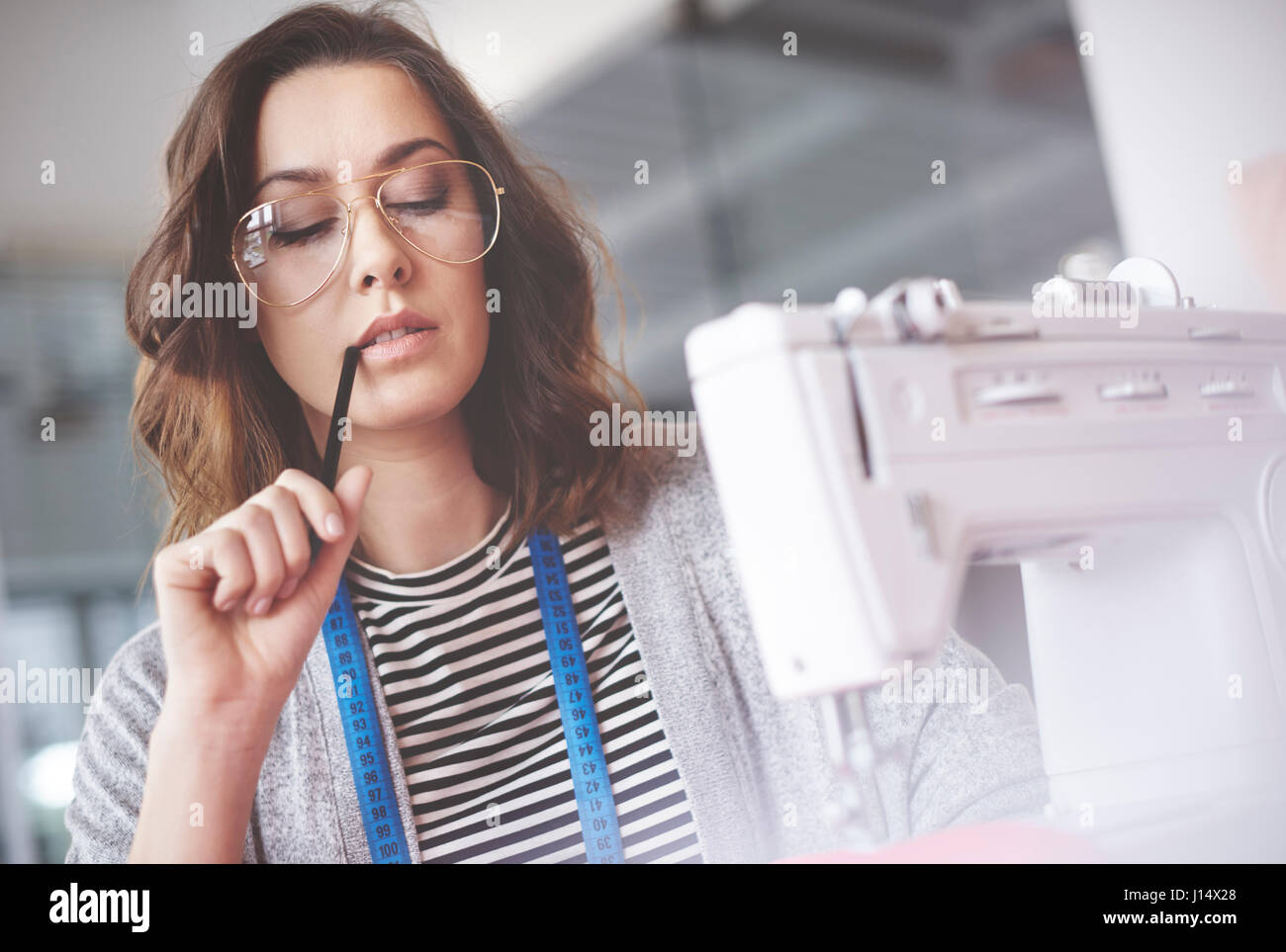 Tailor deliberating on next move - Stock Image