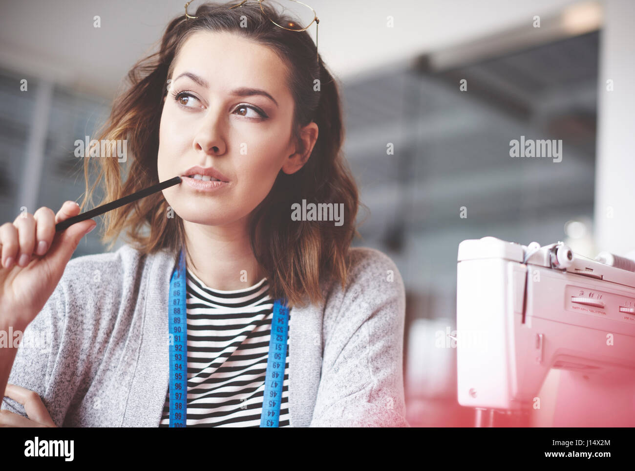 Waist up of confident seamstress - Stock Image