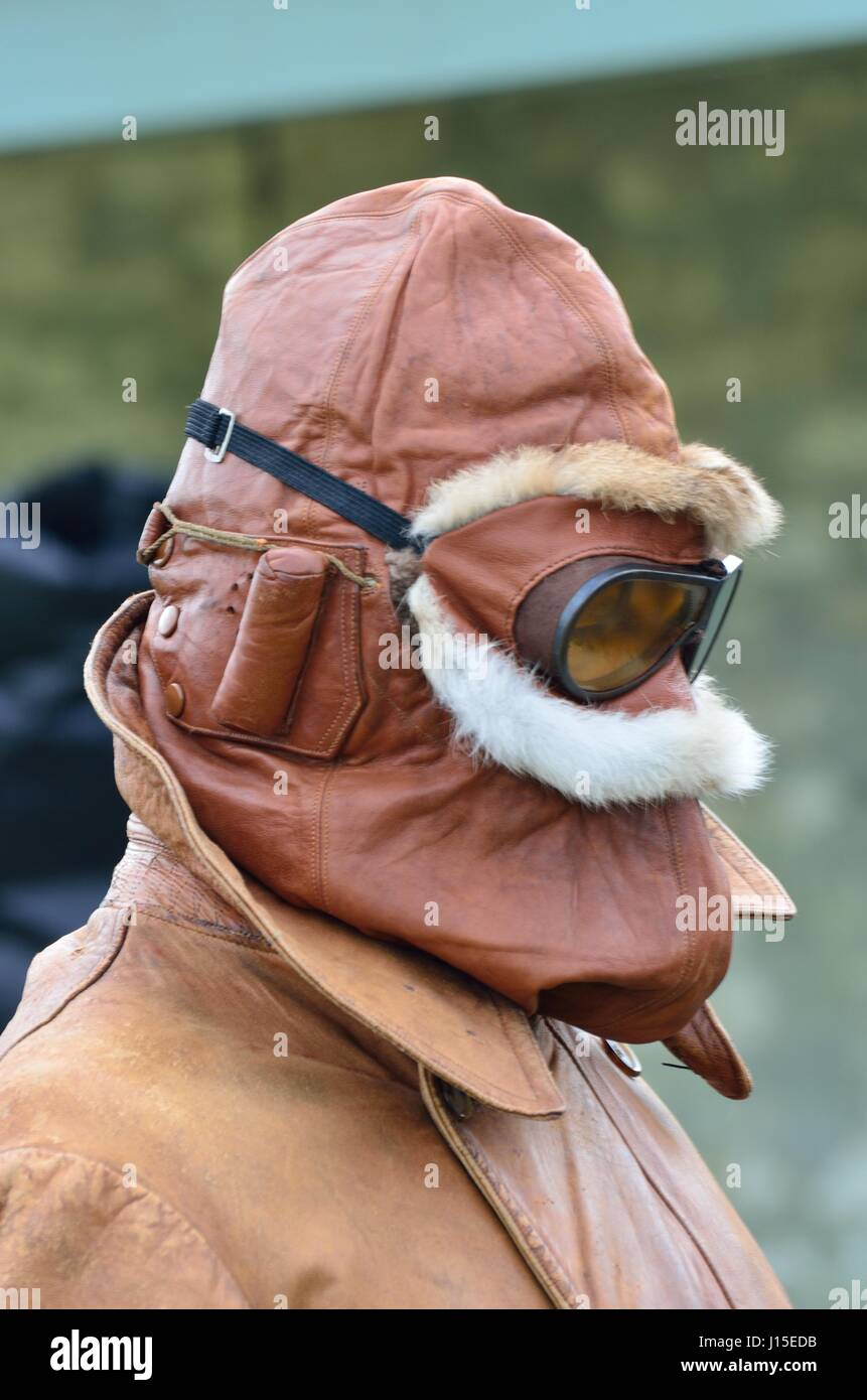 Stowe Maries Airfield Essex ,United Kingdom  - May 14 2014 :  World war one RAF pilot wrapped in warm helmet used - Stock Image