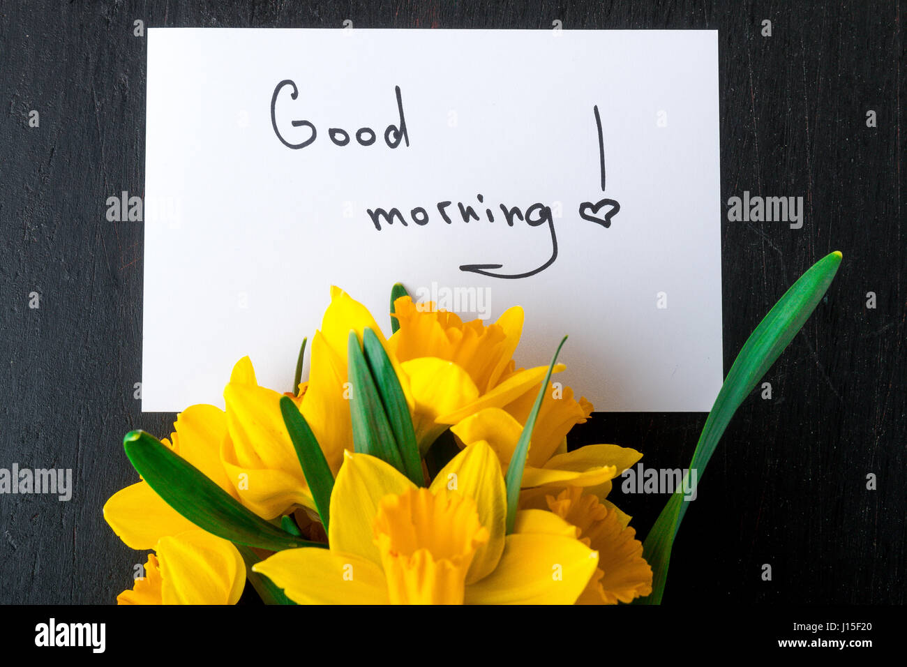 Bouquet Of Daffodil Near Card With Good Morning On Black Background