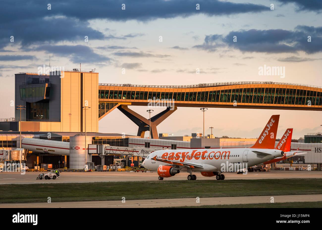 Easyjet plane waiting on the apron at Gatwick airport, near London, United Kingdom. - Stock Image