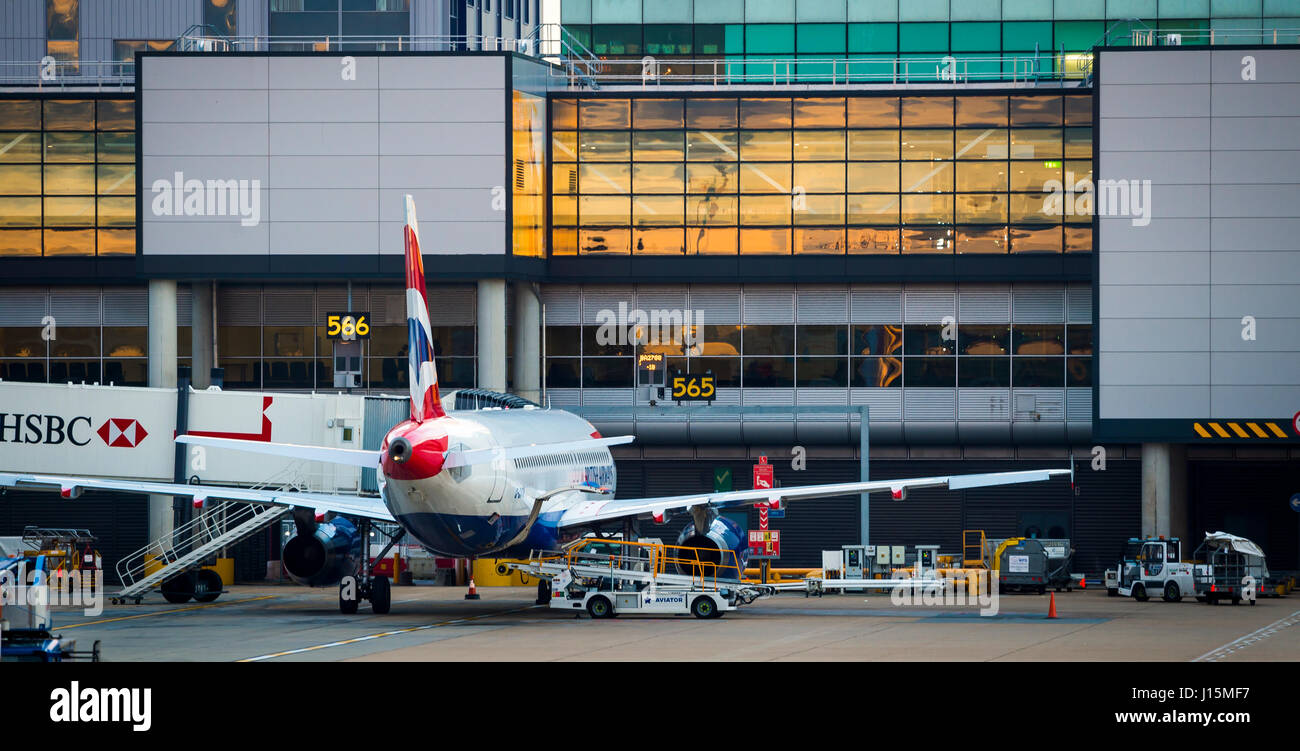 British Airways plane waiting on the apron at Gatwick airport, near London, United Kingdom. - Stock Image