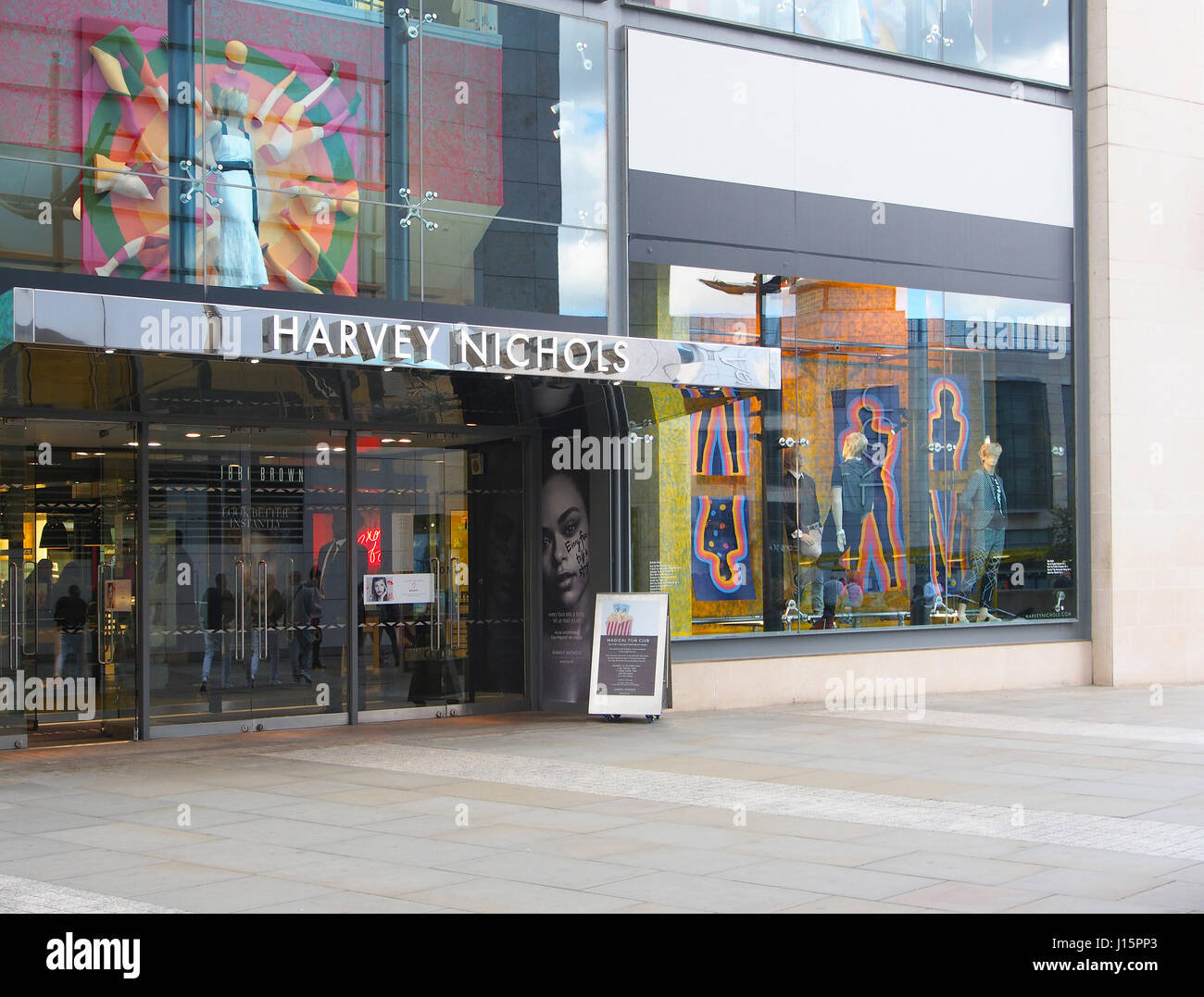 Exterior of the Harvey Nichols shop store in the city centre center of Manchester, England, UK, showing the colourful - Stock Image