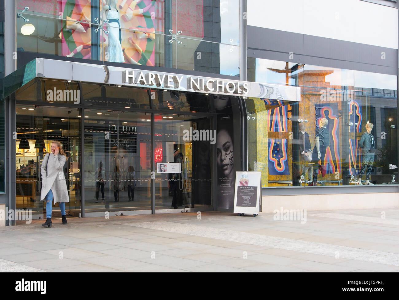 Exterior of Harvey Nichols shop store in the center of Manchester, England, with the colourful window displays and - Stock Image