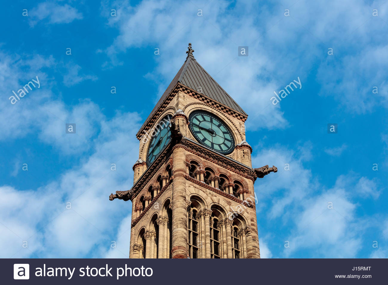 clock tower ornamental stonework on Toronto old city hall a National Historic Site in Romanesque Revival by E J - Stock Image