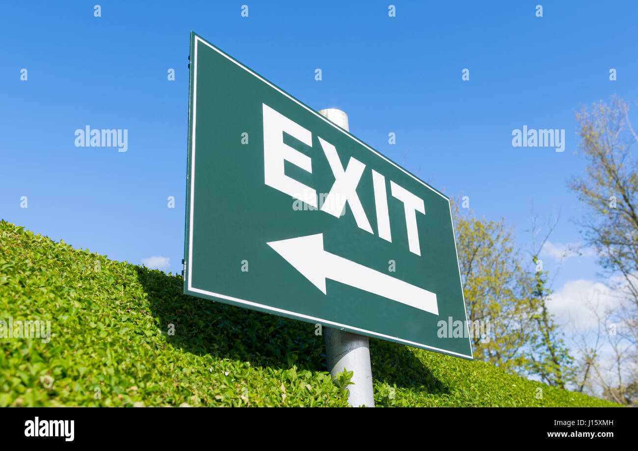 Exit concept. Exit sign with an arrow on a pole. - Stock Image