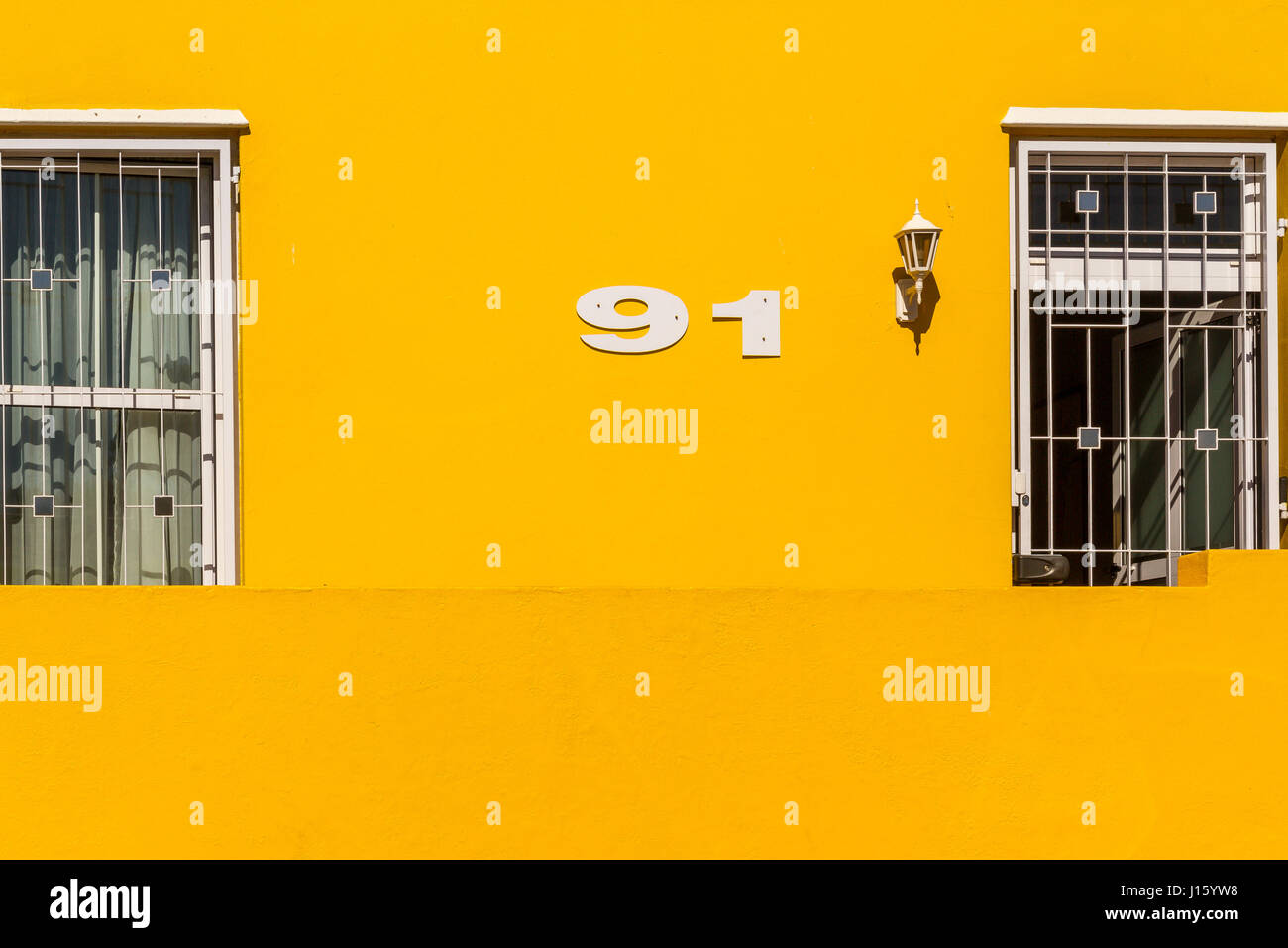 Brightly painted houses in the Bo- Kaap or Malay Quarter area of Cape Town,located on the Slopes of Signal Hill - Stock Image
