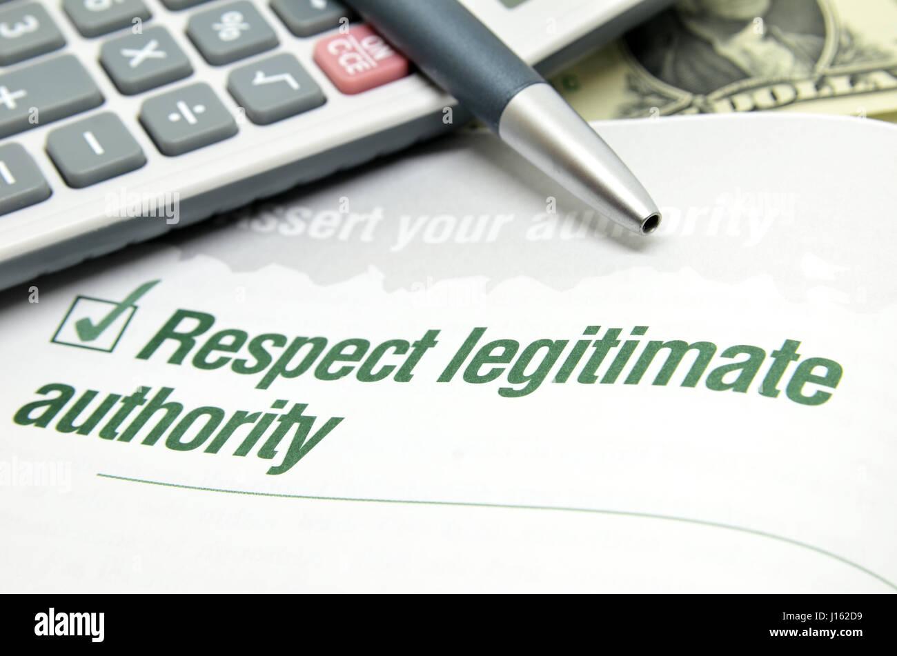 Respect legitimate authority printed on book - Stock Image