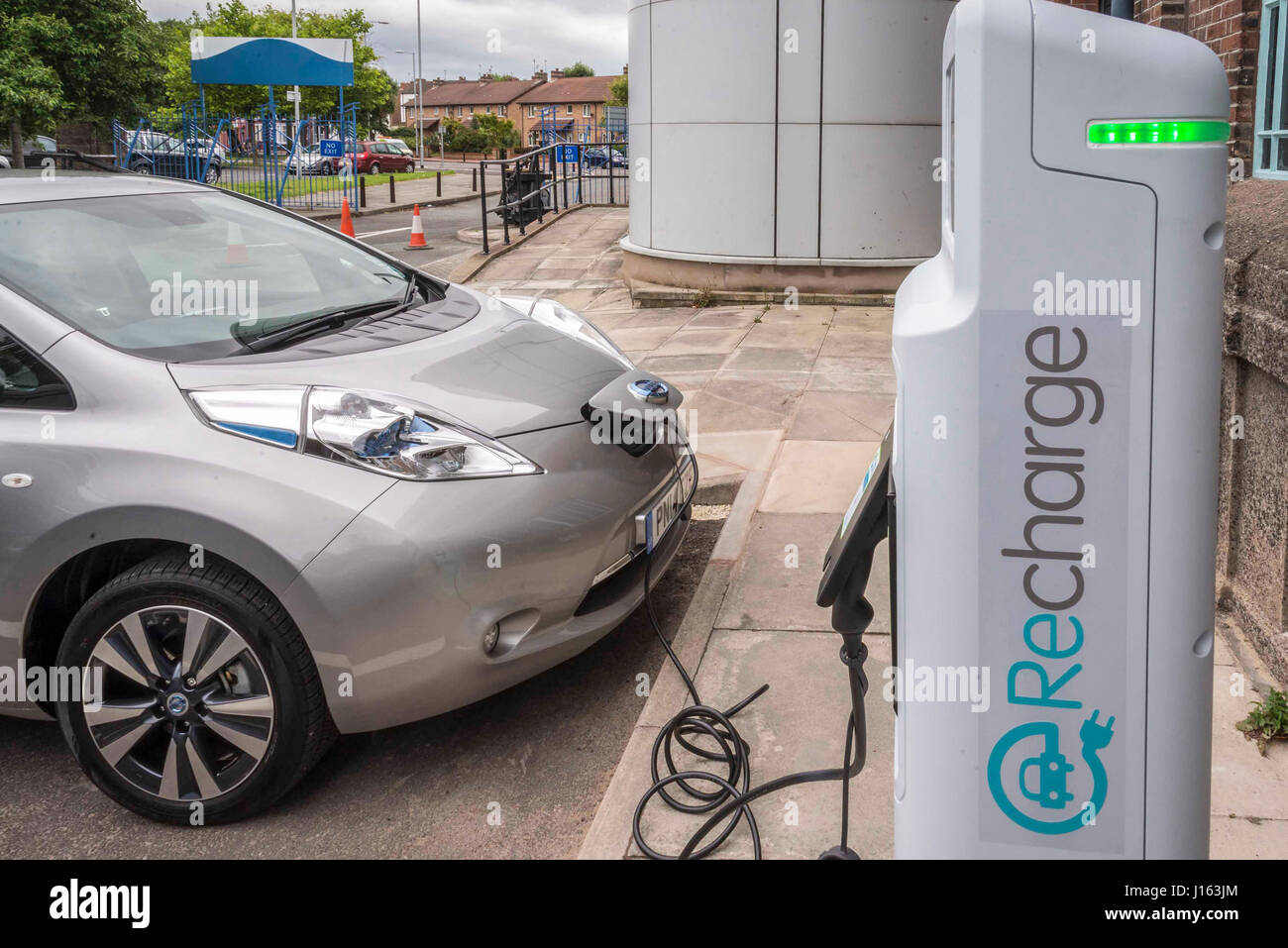 Electric Car charging point in action. Stock Photo