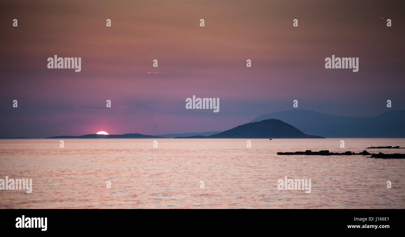 Incredible sunset among the islands in the sea - Stock Image