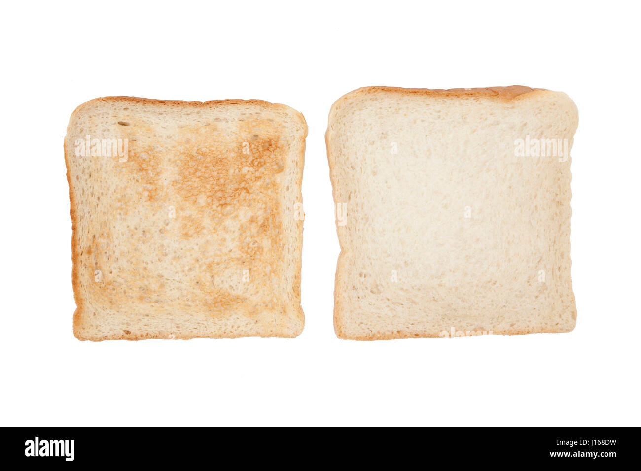Two slices of tast bread (toasted and not toasted) - Stock Image