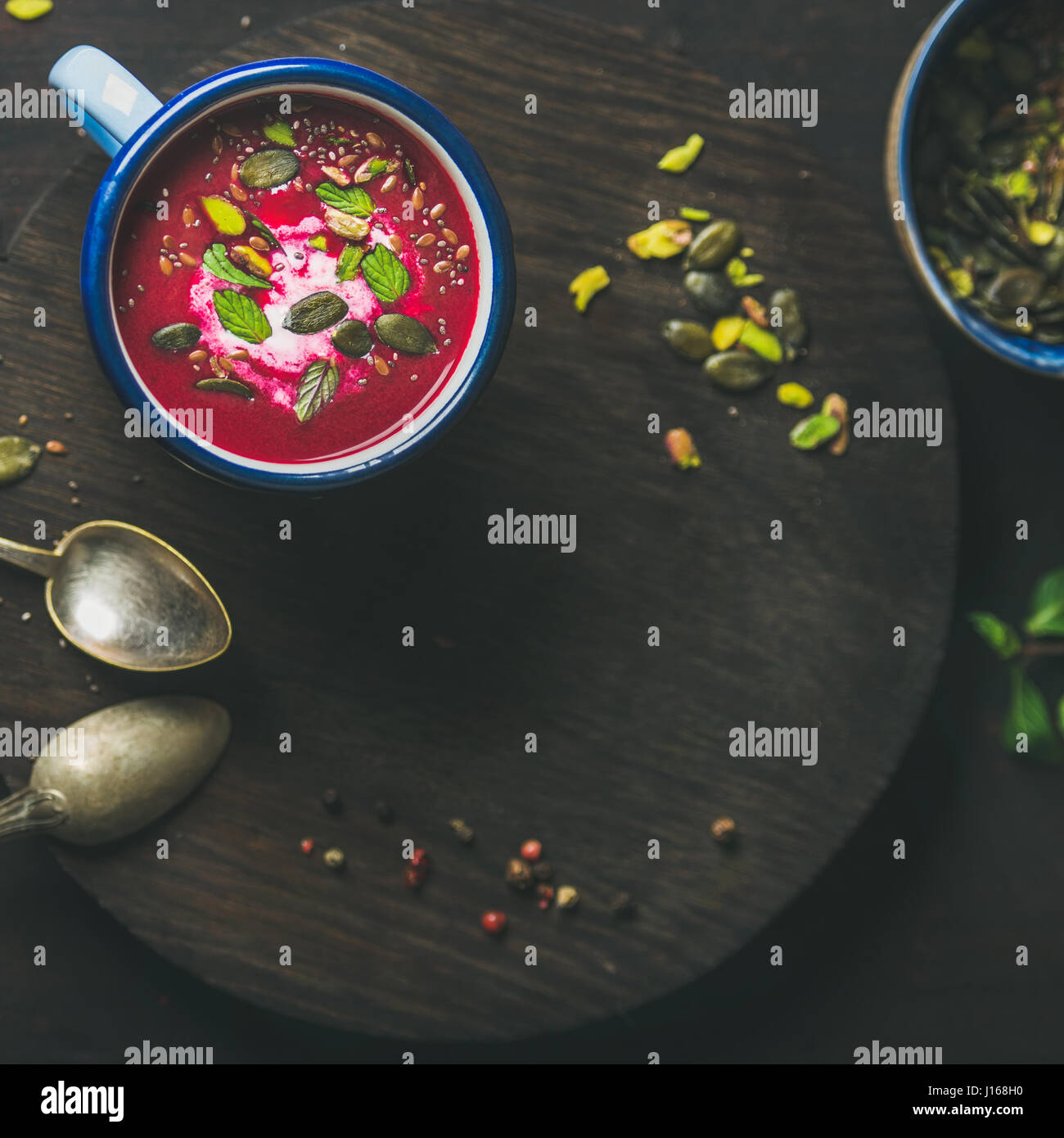 Dieting beetroot soup with mint, pistachio and seeds, copy space - Stock Image