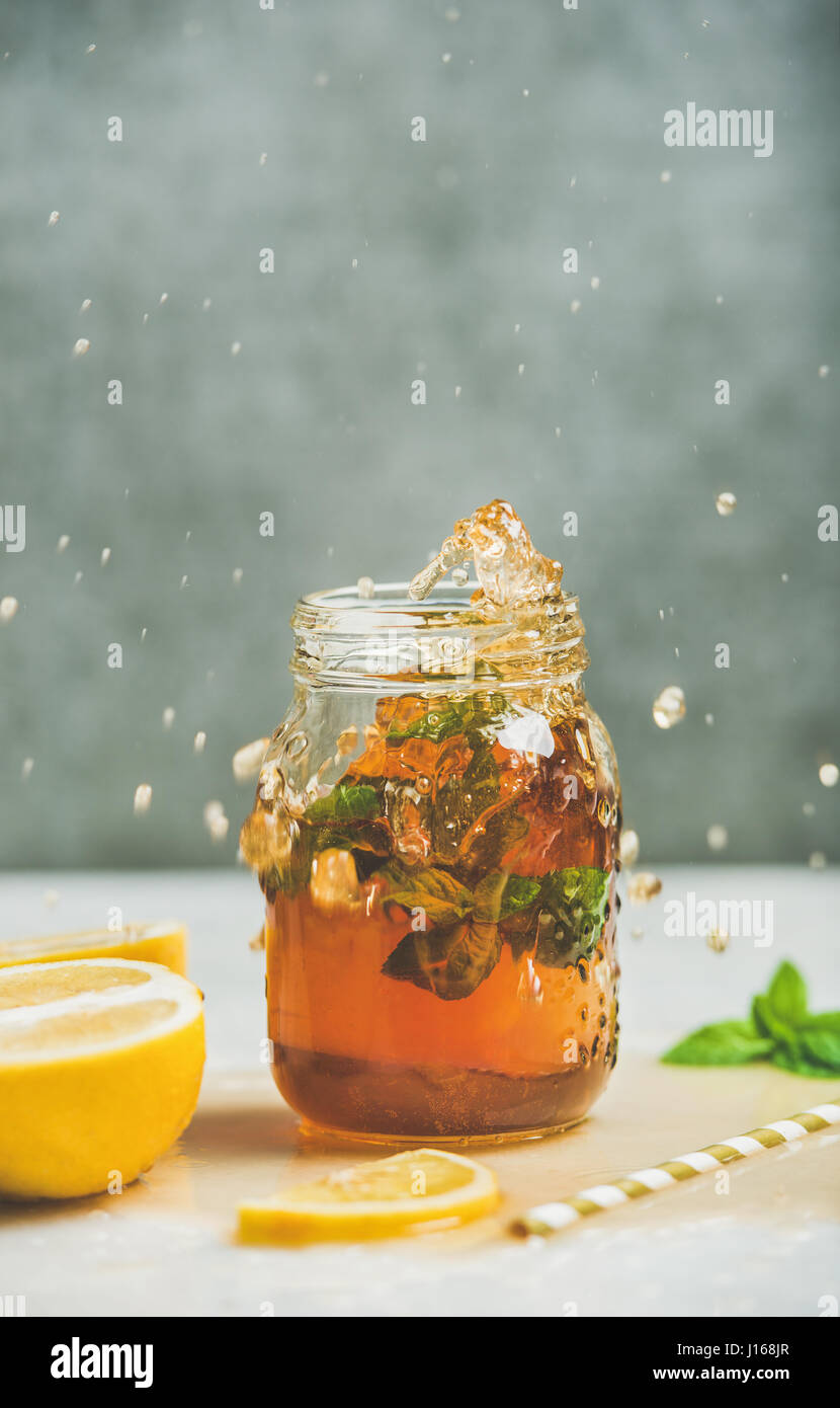 Summer cold Iced tea with lemon and herbs - Stock Image