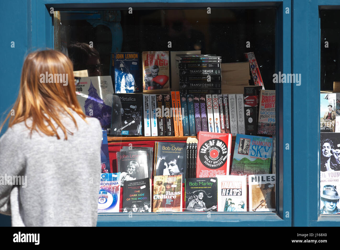 Hay on Wye, Powys, Wales - A visitor looks in a seconhand bookshop window Hay-on-Wye UK - Stock Image